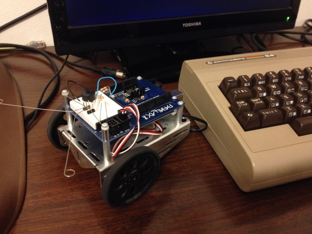 A modern Arduino-powered robot and a vintage 6502-powered C64.  Will this be a perfect match?